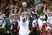 LeBron James of the Cleveland Cavaliers holds the Eastern Conference Championship trophy after defeating the Detroit Pistons in Game Six of the...
