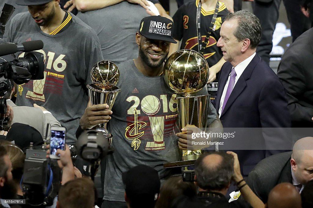 LeBron James #23 of the Cleveland Cavaliers holds the Larry O'Brien Championship Trophy and the Bill Russell NBA Finals Most Valuable Player Award after defeating the Golden State Warriors 93-89 in Game 7 of the 2016 NBA Finals at ORACLE Arena on June 19, 2016 in Oakland, California.
