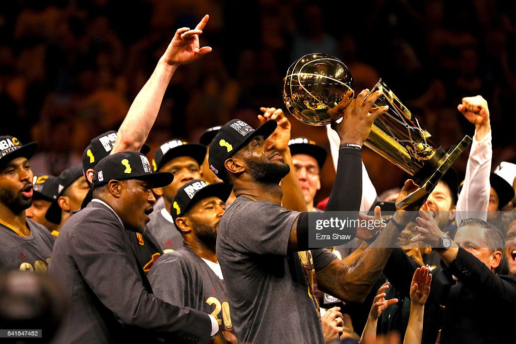 LeBron James of the Cleveland Cavaliers holds the Larry O'Brien Championship Trophy after defeating the Golden State Warriors 9389 in Game 7 of the...