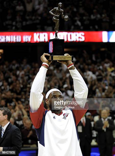 LeBron James of the Cleveland Cavaliers holds up the 20082009 MVP trophy prior playing the Atlanta Hawks in Game One of the Eastern Conference...