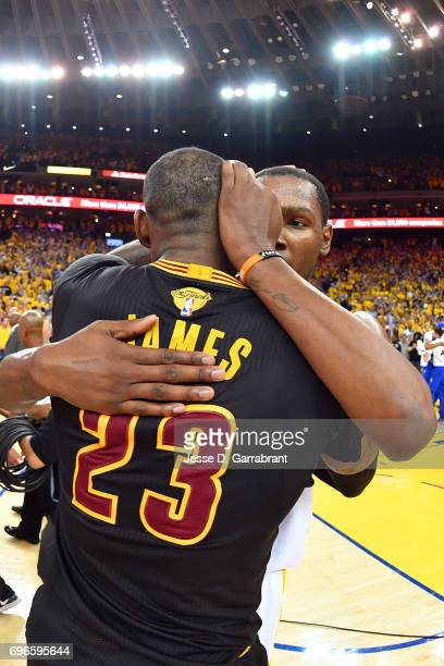 LeBron James of the Cleveland Cavaliers hugs Kevin Durant of the Golden State Warriors after Game Five of the 2017 NBA Finals on June 12 2017 at...