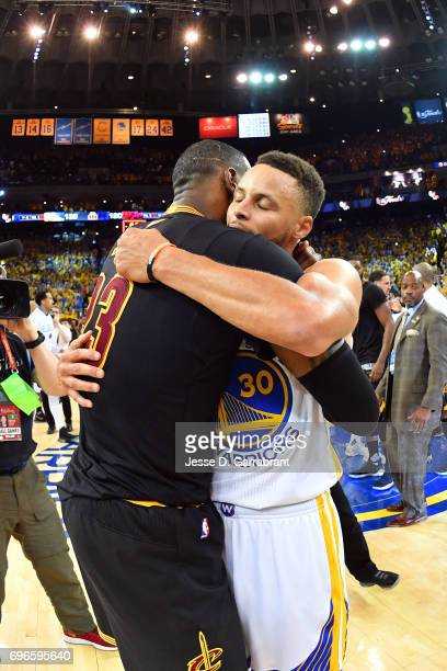 LeBron James of the Cleveland Cavaliers hugs Stephen Curry of the Golden State Warriors after Game Five of the 2017 NBA Finals on June 12 2017 at...