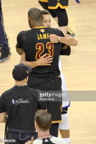 LeBron James of the Cleveland Cavaliers hugs Stephen Curry of the Golden State Warriors in Game Five of the 2017 NBA Finals on June 12 2017 at Oracle...