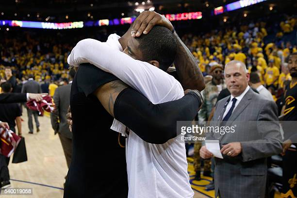 LeBron James of the Cleveland Cavaliers hugs teammate Kyrie Irving after defeating the Golden State Warriors in Game 5 of the 2016 NBA Finals with a...