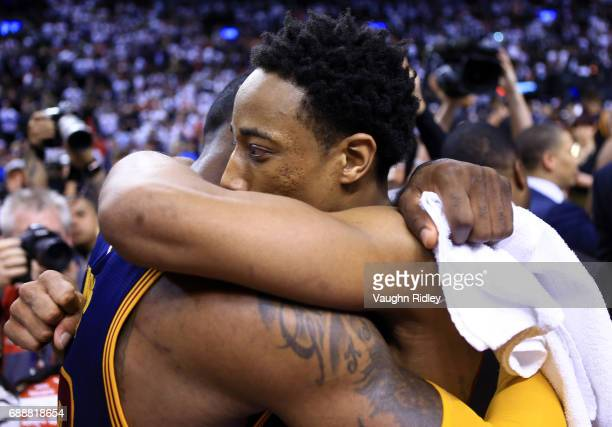 Lebron James of the Cleveland Cavaliers is congratulated by DeMar DeRozan of the Toronto Raptors following Game Four of the Eastern Conference...