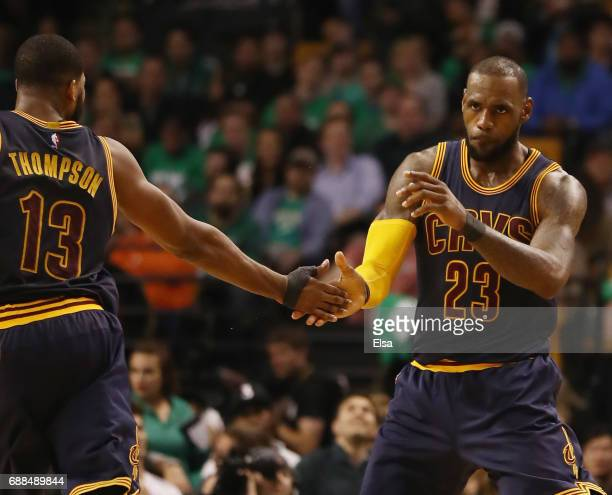 LeBron James of the Cleveland Cavaliers is congratulated by teammate Tristan Thompson of the Cleveland Cavaliers after James hit a three point shot...