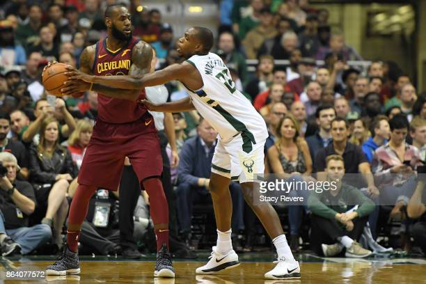 LeBron James of the Cleveland Cavaliers is defended by Khris Middleton of the Milwaukee Bucks during the first quarter of a game at the Bradley...