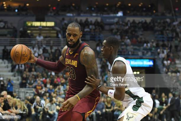 LeBron James of the Cleveland Cavaliers is defended by Tony Snell of the Milwaukee Bucks during a game at the Bradley Center on October 20 2017 in...