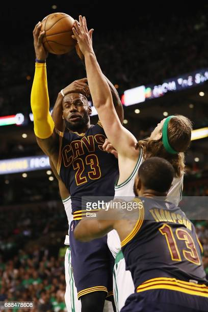 LeBron James of the Cleveland Cavaliers is fouled by Al Horford of the Boston Celtics as Tristan Thompson of the Cleveland Cavaliers and Kelly Olynyk...