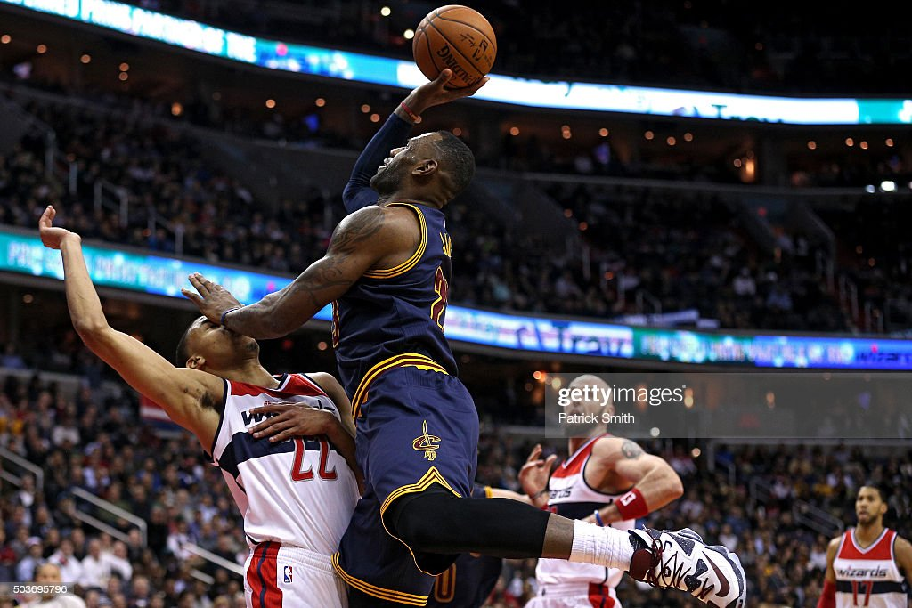 <a gi-track='captionPersonalityLinkClicked' href=/galleries/search?phrase=LeBron+James&family=editorial&specificpeople=201474 ng-click='$event.stopPropagation()'>LeBron James</a> #23 of the Cleveland Cavaliers is fouled by <a gi-track='captionPersonalityLinkClicked' href=/galleries/search?phrase=Otto+Porter+Jr.&family=editorial&specificpeople=10019906 ng-click='$event.stopPropagation()'>Otto Porter Jr.</a> #22 of the Washington Wizards during the first half at Verizon Center on January 6, 2016 in Washington, DC.