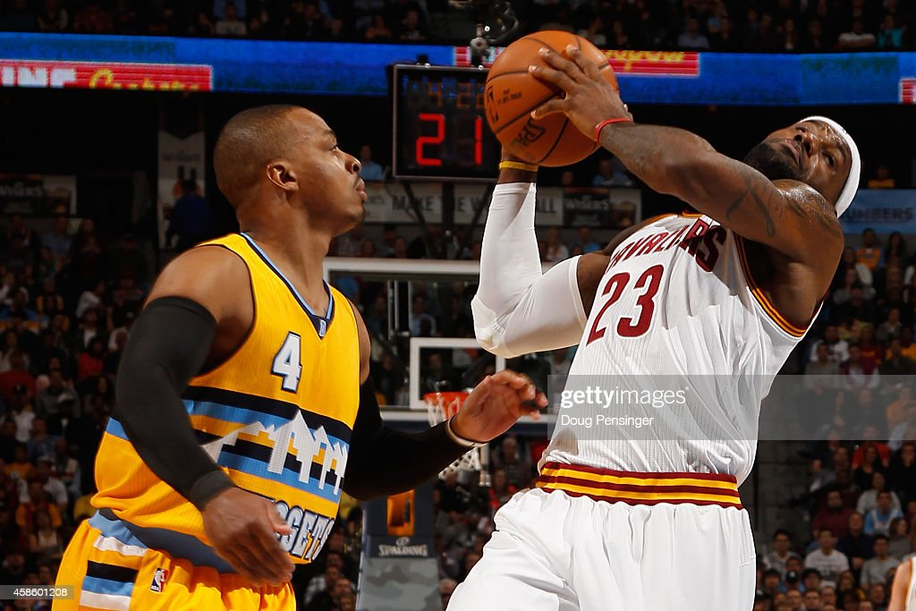 <a gi-track='captionPersonalityLinkClicked' href=/galleries/search?phrase=LeBron+James&family=editorial&specificpeople=201474 ng-click='$event.stopPropagation()'>LeBron James</a> #23 of the Cleveland Cavaliers is fouled by <a gi-track='captionPersonalityLinkClicked' href=/galleries/search?phrase=Randy+Foye&family=editorial&specificpeople=240185 ng-click='$event.stopPropagation()'>Randy Foye</a> #4 of the Denver Nuggets at Pepsi Center on November 7, 2014 in Denver, Colorado.