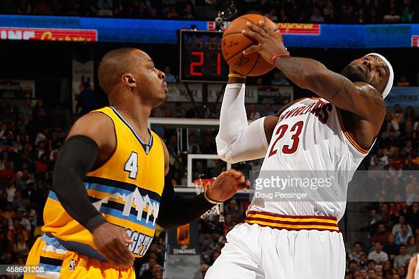 LeBron James of the Cleveland Cavaliers is fouled by Randy Foye of the Denver Nuggets at Pepsi Center on November 7 2014 in Denver Colorado NOTE TO...