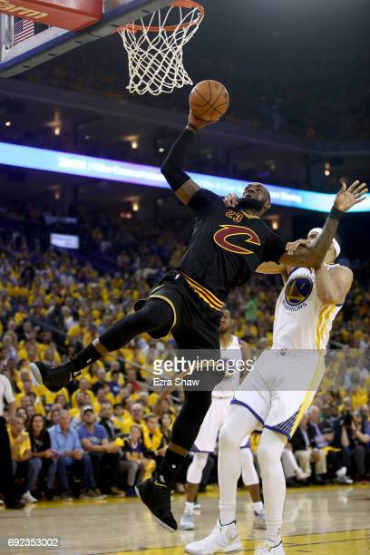 LeBron James of the Cleveland Cavaliers is grabbed by JaVale McGee of the Golden State Warriors in Game 2 of the 2017 NBA Finals at ORACLE Arena on...