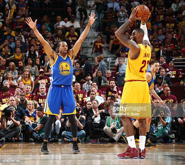 LeBron James of the Cleveland Cavaliers is guarded by Andre Iguodala of the Golden State Warriors during Game Four of the 2015 NBA Finals at The...