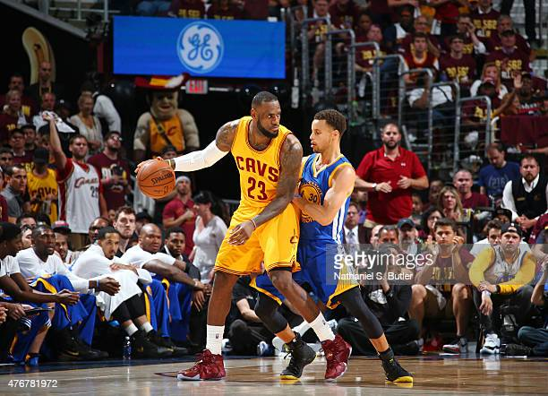 LeBron James of the Cleveland Cavaliers is guarded by Stephen Curry of the Golden State Warriors during Game Four of the 2015 NBA Finals at The...