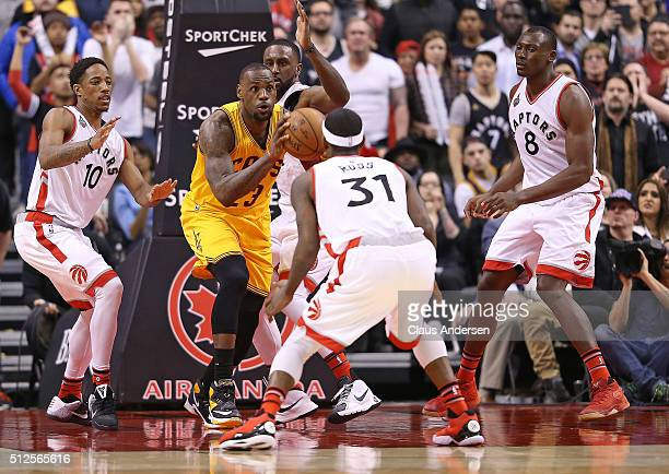 LeBron James of the Cleveland Cavaliers is heavily covered by the Toronto Raptors during an NBA game at the Air Canada Centre on February 26 2016 in...
