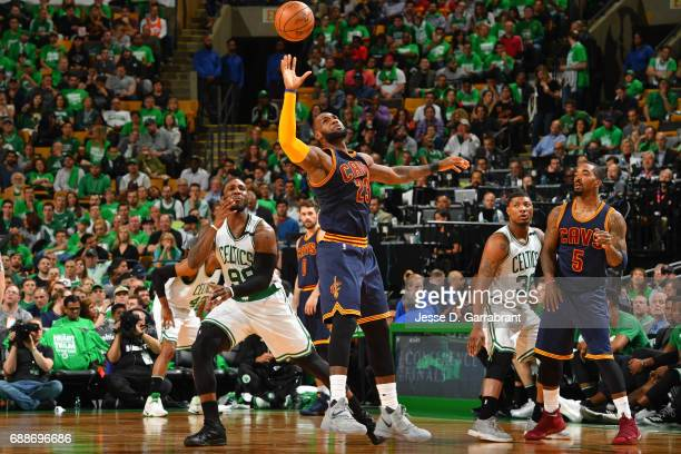 LeBron James of the Cleveland Cavaliers knocks away a loose ball in Game Five of the Eastern Conference Finals against the Boston Celtics during the...