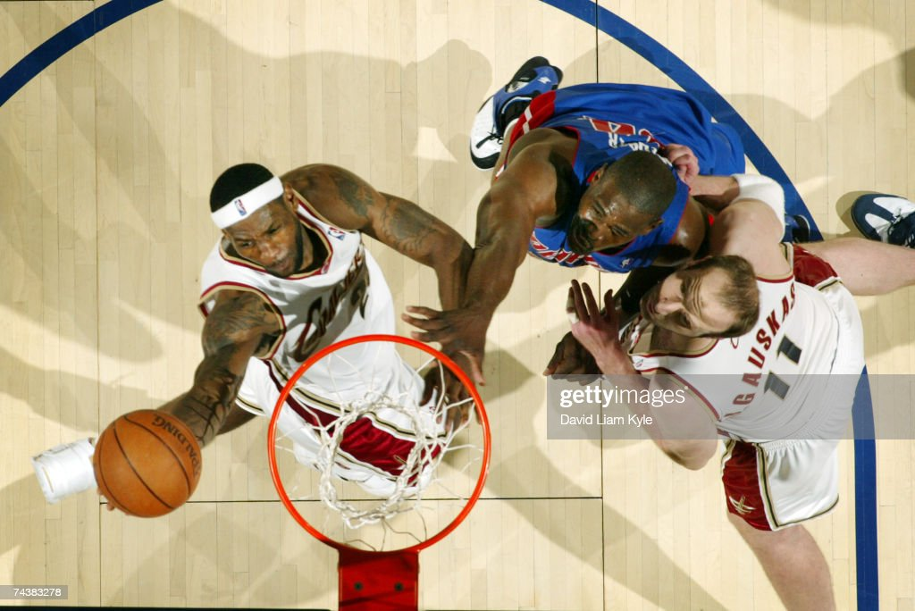 LeBron James of the Cleveland Cavaliers lays the ball in over Chris Webber of the Detroit Pistons in Game Six of the Eastern Conference Finals during...