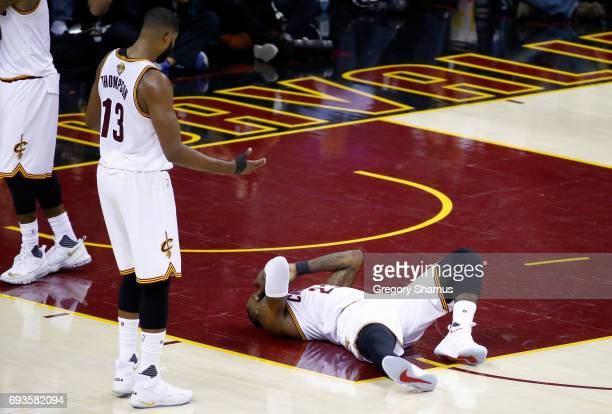 LeBron James of the Cleveland Cavaliers lies on the court after a collision with Tristan Thompson in the first quarter against the Golden State...