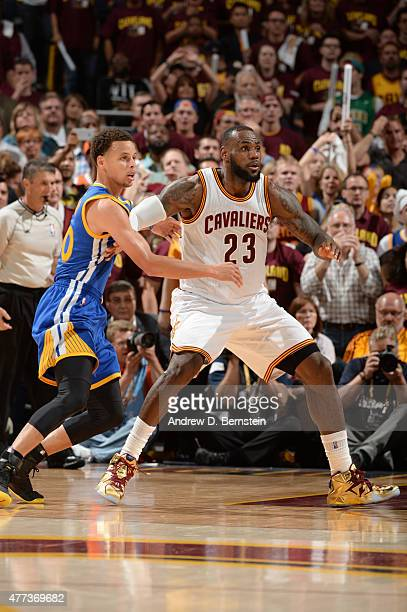 LeBron James of the Cleveland Cavaliers looks for a pass against Stephen Curry of the Golden State Warriors during Game Six of the 2015 NBA Finals at...