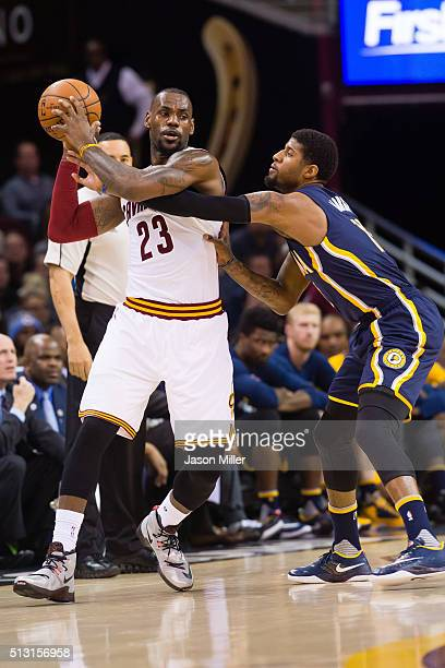LeBron James of the Cleveland Cavaliers looks for a pass while under pressure from Paul George of the Indiana Pacers during the first half at Quicken...