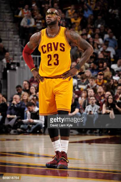 LeBron James of the Cleveland Cavaliers looks on during a game against the Washington Wizards on March 25 2017 at Quicken Loans Arena in Cleveland...