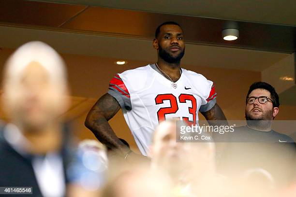 LeBron James of the Cleveland Cavaliers looks on during the College Football Playoff National Championship Game between the Oregon Ducks and the Ohio...