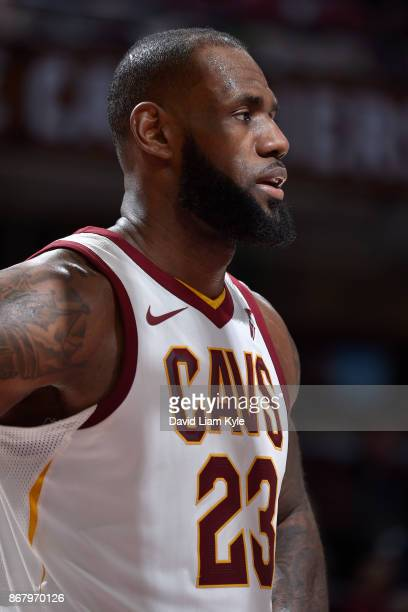 LeBron James of the Cleveland Cavaliers looks on during the game against the New York Knicks on October 29 2017 at Quicken Loans Arena in Cleveland...