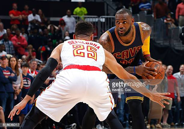 LeBron James of the Cleveland Cavaliers looks to drive against Thabo Sefolosha of the Atlanta Hawks at Philips Arena on April 1 2016 in Atlanta...