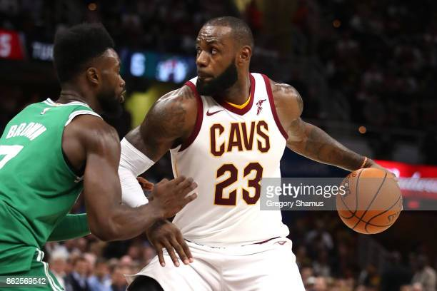 LeBron James of the Cleveland Cavaliers looks to get around Jaylen Brown of the Boston Celtics during the first half at Quicken Loans Arena on...