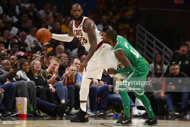 LeBron James of the Cleveland Cavaliers looks to get around Kyrie Irving of the Boston Celtics during the second half at Quicken Loans Arena on...