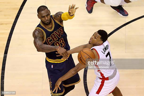 LeBron James of the Cleveland Cavaliers looks to pass in the second quarter against Kyle Lowry of the Toronto Raptors in game four of the Eastern...