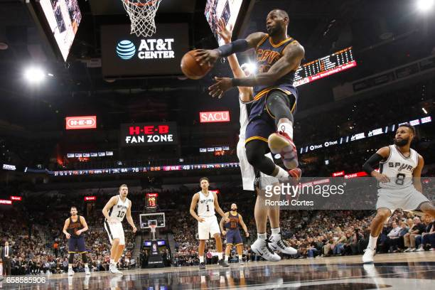 LeBron James of the Cleveland Cavaliers looks to pass off against the San Antonio Spurs at ATT Center on March 27 2017 in San Antonio Texas NOTE TO...