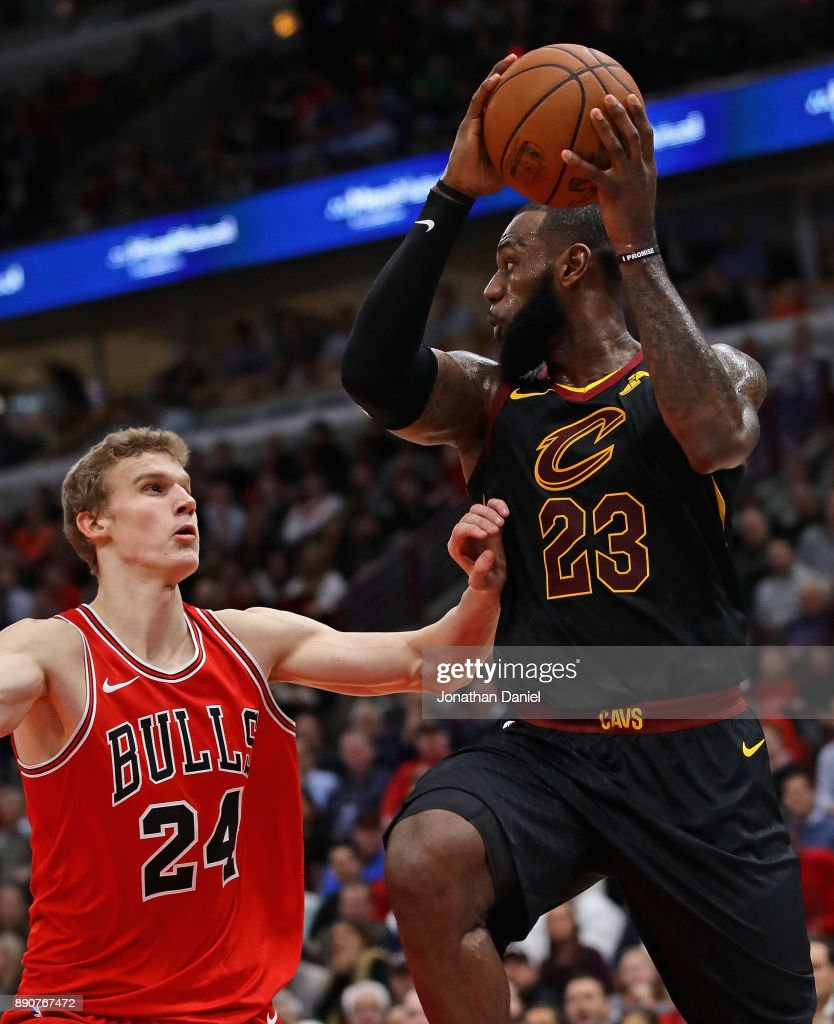 LeBron James #23 of the Cleveland Cavaliers looks to pass over Lauri Markkanen #24 of the Chicago Bulls at the United Center on December 4, 2017 in Chicago, Illinois. The Cavaliers defeated the Bulls 113-91.