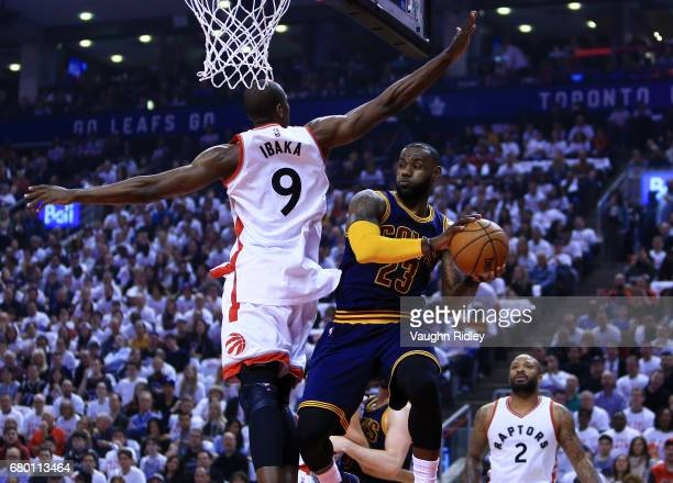 Lebron James of the Cleveland Cavaliers looks to pass the ball as Serge Ibaka of the Toronto Raptors defends in the first half of Game Four of the...