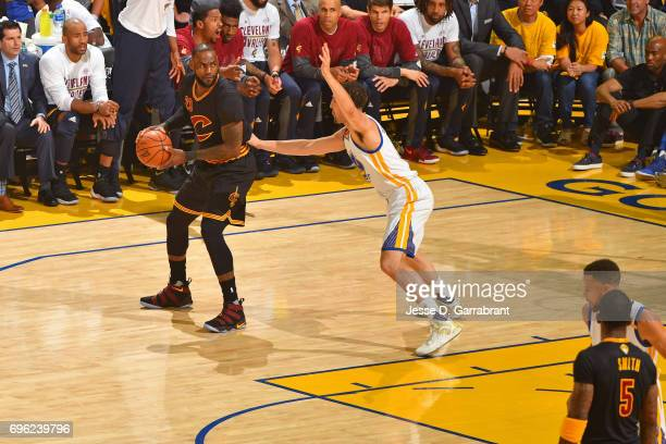 LeBron James of the Cleveland Cavaliers looks to pass the ball while guarded by Klay Thompson of the Golden State Warriors in Game Five of the 2017...