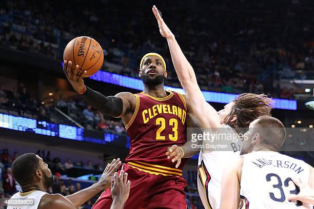 LeBron James of the Cleveland Cavaliers makes a shot over Luke Babbitt of the New Orleans Pelicans at Smoothie King Center on December 12 2014 in New...