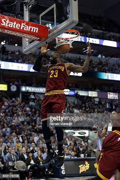 LeBron James of the Cleveland Cavaliers makes a slam dunk against the Dallas Mavericks in the second half at American Airlines Center on January 30...