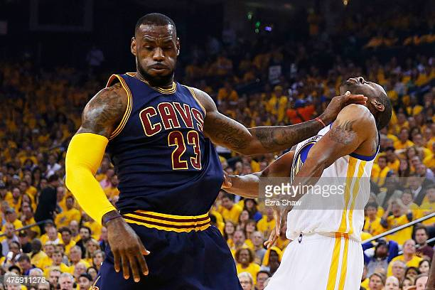 LeBron James of the Cleveland Cavaliers makes contact with Andre Iguodala of the Golden State Warriors in the first quarter during Game One of the...