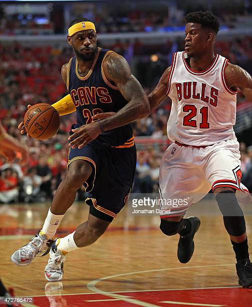 LeBron James of the Cleveland Cavaliers moves against Jimmy Butler of the Chicago Bulls in Game Three of the Eastern Conference Semifinals of the...