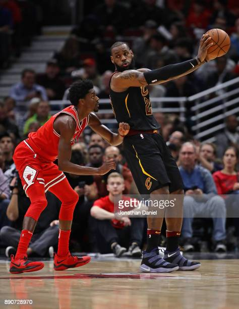 LeBron James of the Cleveland Cavaliers moves against Justin Holiday of the Chicago Bulls at the United Center on December 4 2017 in Chicago Illinois...