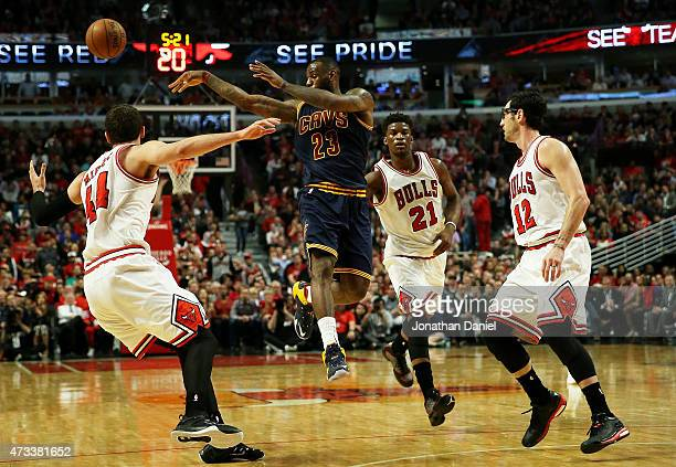 LeBron James of the Cleveland Cavaliers passes against Nikola Mirotic of the Chicago Bulls in the second quarter during Game Six of the Eastern...