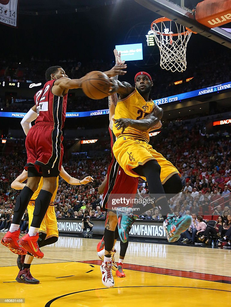 LeBron James of the Cleveland Cavaliers passes during a game against the Miami Heat at American Airlines Arena on December 25 2014 in Miami Florida...