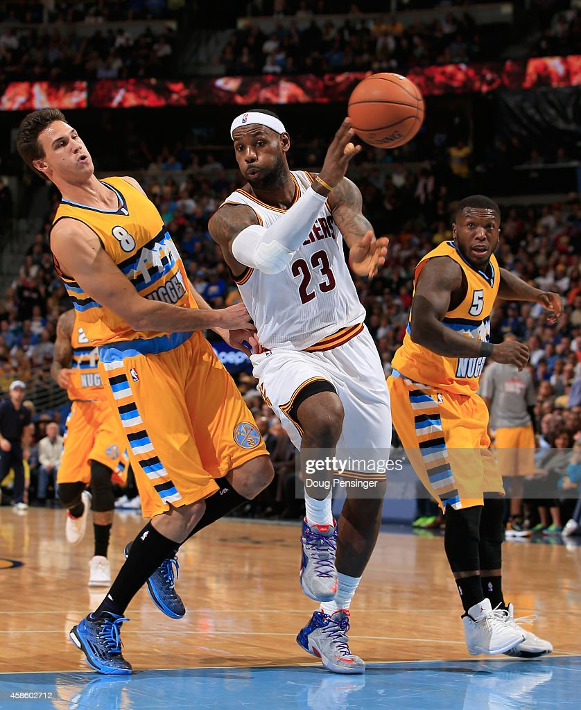 <a gi-track='captionPersonalityLinkClicked' href=/galleries/search?phrase=LeBron+James&family=editorial&specificpeople=201474 ng-click='$event.stopPropagation()'>LeBron James</a> #23 of the Cleveland Cavaliers passes the ball against the defense of <a gi-track='captionPersonalityLinkClicked' href=/galleries/search?phrase=Danilo+Gallinari&family=editorial&specificpeople=4644476 ng-click='$event.stopPropagation()'>Danilo Gallinari</a> #8 and <a gi-track='captionPersonalityLinkClicked' href=/galleries/search?phrase=Nate+Robinson&family=editorial&specificpeople=208906 ng-click='$event.stopPropagation()'>Nate Robinson</a> #5 of the Denver Nuggets at Pepsi Center on November 7, 2014 in Denver, Colorado.