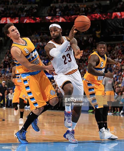 LeBron James of the Cleveland Cavaliers passes the ball against the defense of Danilo Gallinari and Nate Robinson of the Denver Nuggets at Pepsi...