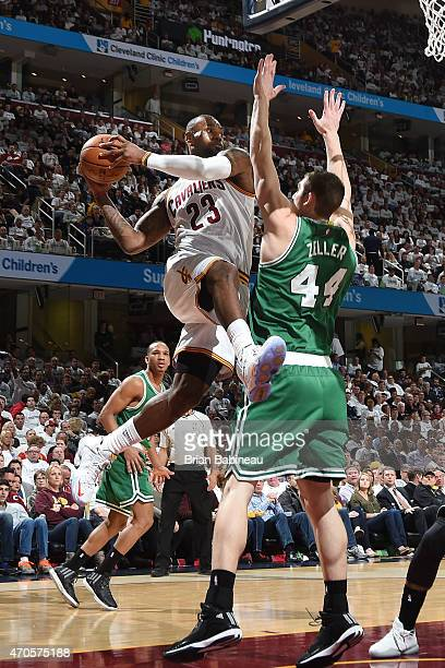 LeBron James of the Cleveland Cavaliers passes the ball against Tyler Zeller of the Boston Celtics during Game Two of the Eastern Conference...