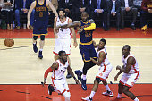 LeBron James of the Cleveland Cavaliers passes the ball during the first half against the Toronto Raptors in game three of the Eastern Conference...