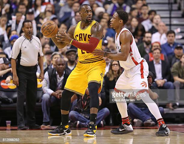 LeBron James of the Cleveland Cavaliers plays against DeMar DeRozan of the Toronto Raptors during an NBA game at the Air Canada Centre on February 26...