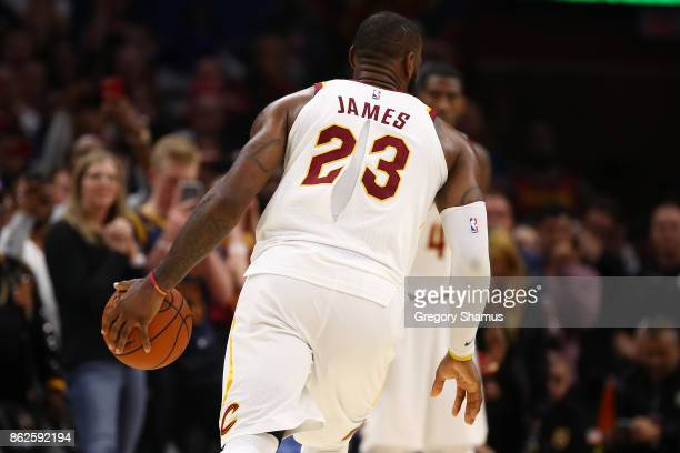 LeBron James of the Cleveland Cavaliers plays with a ripped jersey during the second half against the Boston Celtics at Quicken Loans Arena on...