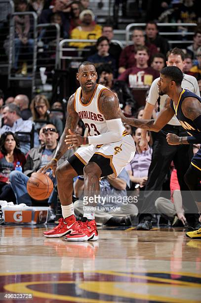 LeBron James of the Cleveland Cavaliers posts up against Paul George of the Indiana Pacers on November 8 2015 at Quicken Loans Arena in Cleveland...